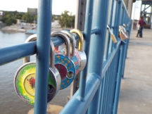 Lovers' locks on walking bridge to North Little Rock
